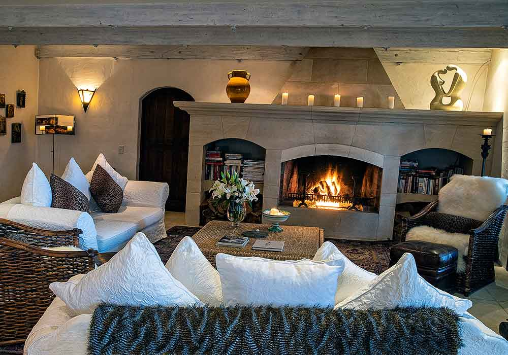 Luxury lodge accommodation - cosy living room with open fireplace